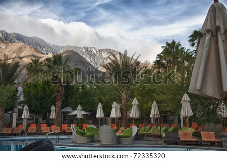 Beautiful Palm Springs resort with the mountains in the background - stock photo