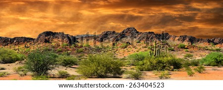 Beautiful panorama all natural Image of Cloud formations and rocky Mountains near the Border of New Mexico and mexico - stock photo
