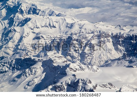 Beautiful panorama of the Alps covered with snow and clouds - stock photo