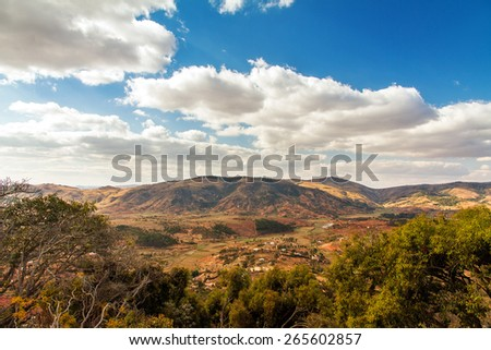 Beautiful panorama of the landscape of Madagascar seen from the royal hill Ambohimanga with a beautiful cloudscape - stock photo