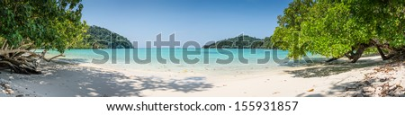 Beautiful Panorama Wild Tropical Beach. Turquoise Sea at Surin Marine Park Island. Thailand. South East Asia. - stock photo