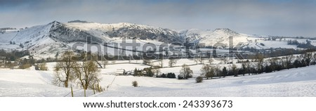Beautiful panorama Winter landscape snow covered countryside in late afternoon light - stock photo