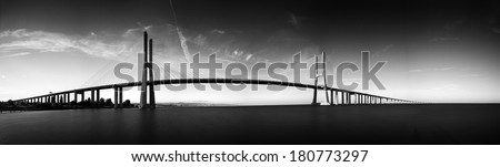 Beautiful panoramic image of the Vasco da Gama bridge in Lisbon, Portugal - stock photo