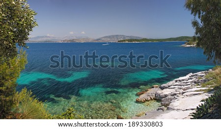 Beautiful panoramic seascape with transparent turquoise sea. Corfu, Greece - stock photo