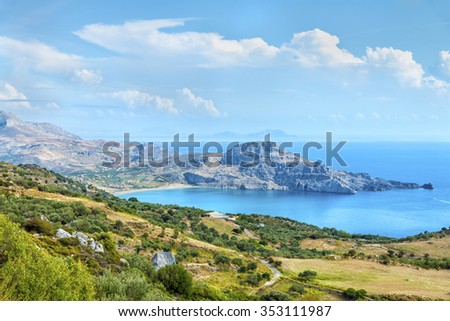 Beautiful panoramic view from the height on the Cretan settlement of Plakias with its beautiful hilly relief, beach and coastline of mediterranean sea.District of Rethymno.Crete island.Greece.Europe. - stock photo