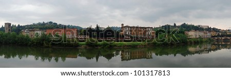 Beautiful panoramic view of Florence with reflections in the Arno River. - stock photo
