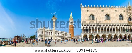 Beautiful panoramic view of historic Piazzetta San Marco with Doge's Palace and famous St Mark's Campanile and the National Library of St Mark's on a sunny day with blue sky, Venice, Italy - stock photo