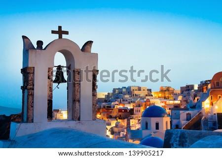 beautiful panoramic view of Santorini, Greece, traditional church on foreground - stock photo