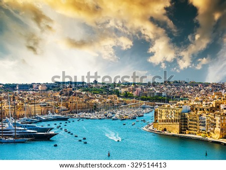 beautiful panoramic view on Valletta from the sea at sunset in Malta - stock photo