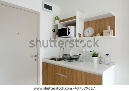 Beautiful pantry with utensil in modern apartment - stock photo