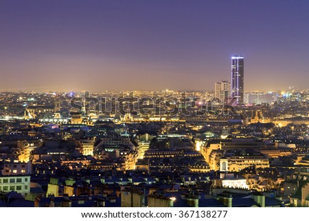 Beautiful Paris night cityscape seen from Montmartre with the tour Montparnasse skyscraper at night - stock photo