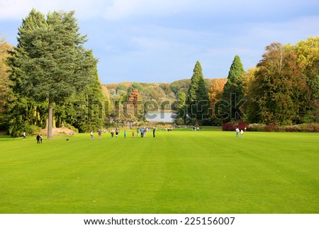 Beautiful park with lake, excellent destination for family weekend fun - stock photo
