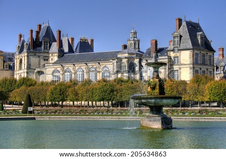 Beautiful Park with pond of ancient Fontainebleau palace. Palace of Fontainebleau - one of the largest Medieval royal chateaux in France (55 km from Paris) - stock photo