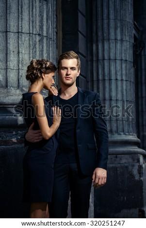 Beautiful passionate couple over city background. Fashion style photo. - stock photo