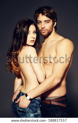 Beautiful passionate naked couple in love. Studio shot.  - stock photo