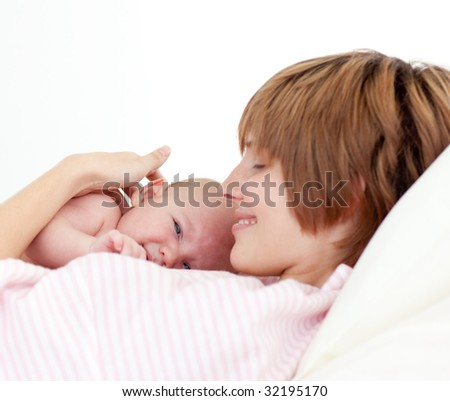 Beautiful patient with newborn baby in bed in hospital - stock photo