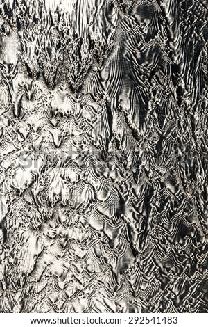 beautiful pattern of flowing water at a metal wall - stock photo