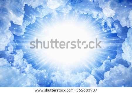 Beautiful peaceful background - beautiful blue skies with bright beams from above, light from heaven - stock photo