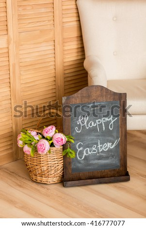 Beautiful peonies in a basket on the background. Happy Easter/ - stock photo