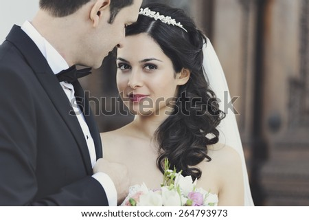 Beautiful, perfect couple posing on their wedding day. Close up shoot - stock photo