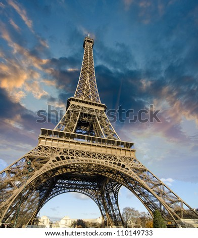 Beautiful photo of the Eiffel tower in Paris with gorgeous sky colors and wide angle perspective, France - stock photo