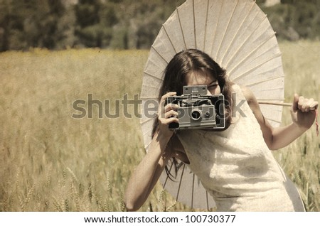 Beautiful photographer. Photo in old image style. - stock photo