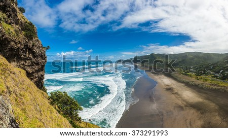 Beautiful Piha beach near Auckland seen from the mighty Lion Rock, New Zealand - stock photo