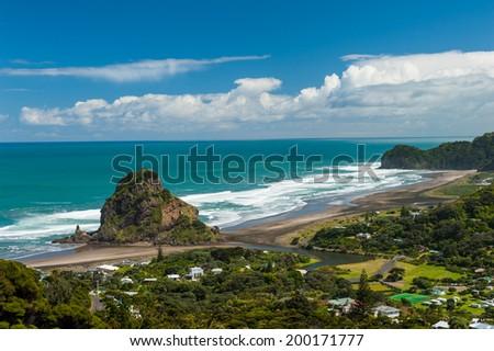 Beautiful Piha beach near Auckland with a mighty Lion Rock, New Zealand - stock photo
