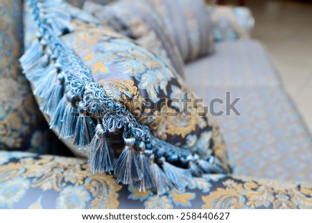 Beautiful Pillow on sofa at a home - stock photo