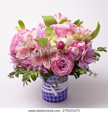 Beautiful pink bouquet with astrantia, fresia, rose, ranunculus. Square image, selective focus - stock photo