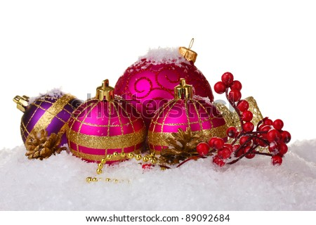 beautiful pink Christmas balls and cones on snow isolated on white - stock photo