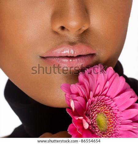 Beautiful pink lips next to gerber flower - stock photo