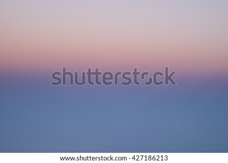 Beautiful pink orange purple sky view from window seat for abstract background - stock photo