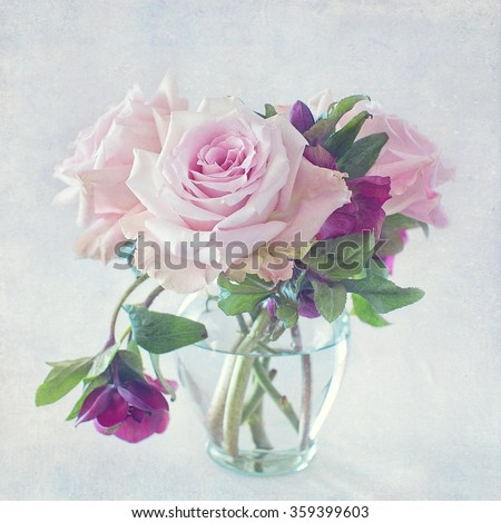 beautiful pink rose flowers in a vase on a vintage background - stock photo
