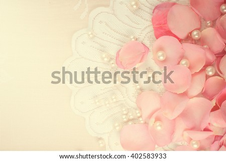 Beautiful pink rose petals with pearls - stock photo