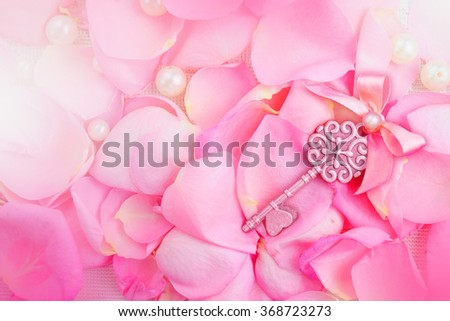 Beautiful pink rose petals with pearls.The key to my heart - stock photo