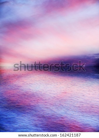 Beautiful pink sunset, airy or heavenly, reflected on the water - stock photo