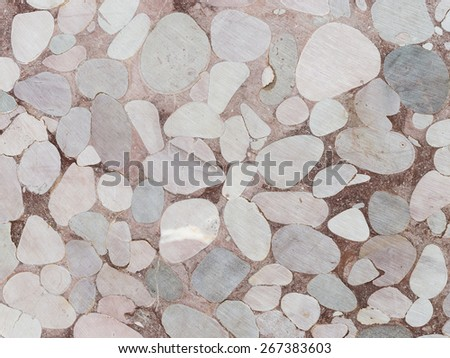 beautiful plate for laying on the floor or a wall made of smooth marble spilite processed stones held together with resin cement - stock photo