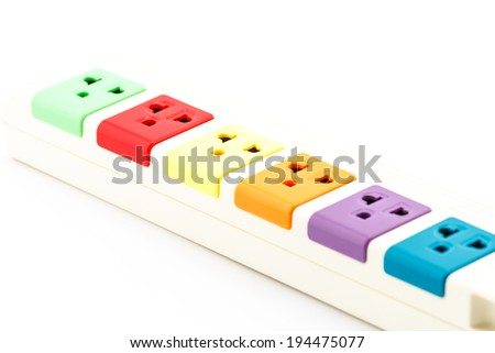 Beautiful plugs colorful plugged into electric power bar. - stock photo