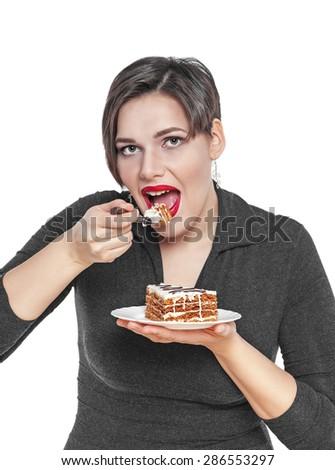 Beautiful plus size woman eating cake isolated on white background - stock photo