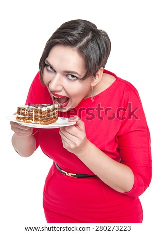Beautiful plus size woman eating cake isolated over white - stock photo