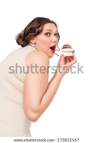 Beautiful plus size woman eating pastry - stock photo