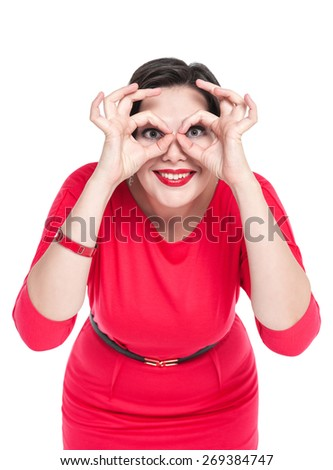 Beautiful plus size woman gesturing glasses with her hands isolated  - stock photo