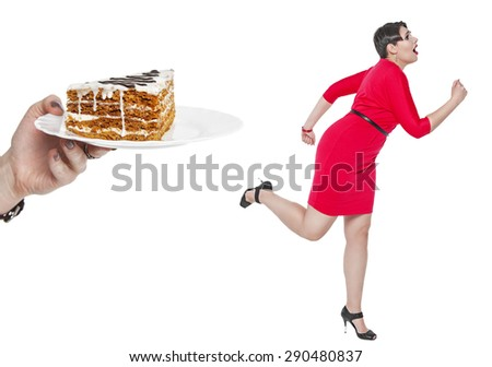 Beautiful plus size woman run away from cake isolated on white background - stock photo