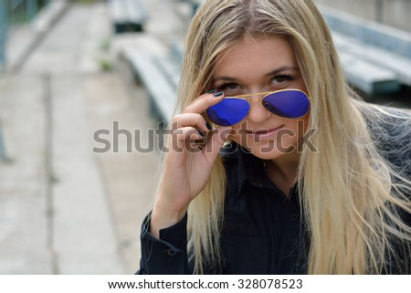 Beautiful Police Girl posing in park and at the police station - stock photo