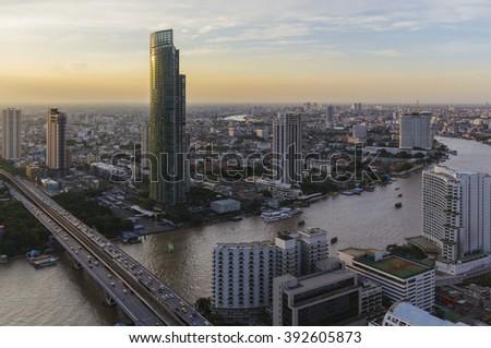 beautiful popular Bangkok sunset view twilight color Chao Phraya River Sathorn Taksin bridge thailand - stock photo