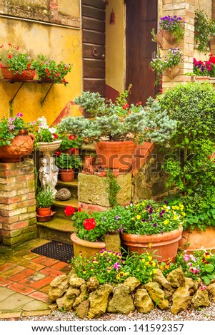 Beautiful porch decorated with flowers in the countryside, Italy - stock photo