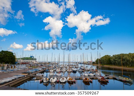 Beautiful port for luxury yachts in the rays of the setting summer sun. Sunset at the port for yachts. Yacht club - stock photo