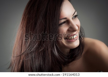 Beautiful portrait of a carefree friendly approachable girl with a stunning smile - stock photo