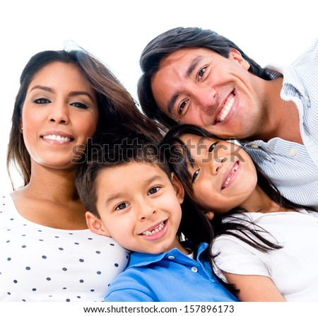 Beautiful portrait of a happy family smiling  - stock photo